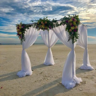 4 Post Arch w/ White Draping $300